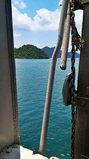 A ferry trip, heading towards the island paradise.