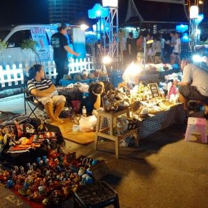 Street vendors in Bangsaen facing a quiet night, devoid of customers. Image by Zashnain Zainal.